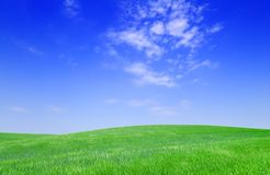 Idyllic view, green hills and blue sky. Idyllic landscape, view on green fields, blue sky and white clouds royalty free stock image