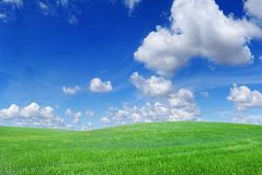 Idyllic view, green hills and blue sky. Idyllic landscape, view on green fields, blue sky and white clouds royalty free stock photo