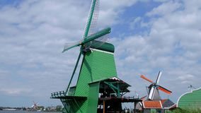 Idyllic view over the typical windmills in Holland stock footage