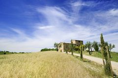 Idyllic view, typical Tuscany farmhouse among fields. Italian landscape, typical Tuscany farmhouse among fields and cypresses royalty free stock photo