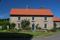 Idyllic village cottage in summer Royalty Free Stock Photography