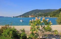 Idyllic waterside promenade, lake tegersee Stock Photo
