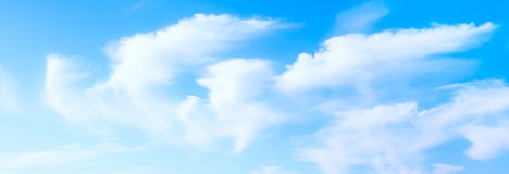 Idyllic white fluffy clouds in the blue sky Stock Image