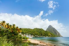 Idyllic beach at Caribbean. Idyllic white sand tropical beach with view to Piton mountains in Saint Lucia Caribbean stock image