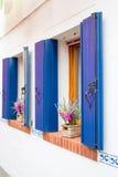 Idyllic windows with flowers stock image