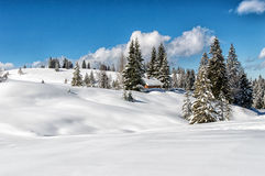 Idyllic winter landscape in the Alps with traditional mountain l Stock Image