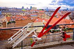 Idyllic Zagreb upper town Christmas market decorations. Skis and ice skates with city rooftops view, capital of Croatia Royalty Free Stock Image