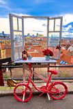 Idyllic Zagreb upper town Christmas market decorations. View through window on city rooftops and bicycle view, capital of Croatia Royalty Free Stock Photo