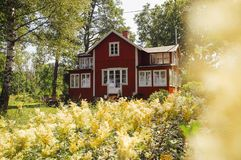Idyllically situated typical red Swedish country house stock photo