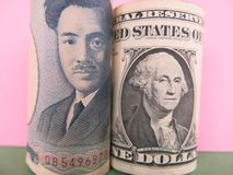 Iene japonês e dólares americanos Foto de Stock