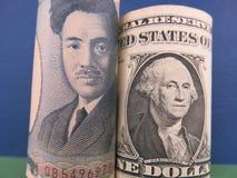 Iene japonês e dólares americanos Foto de Stock Royalty Free
