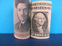Iene japonês e dólares americanos Imagens de Stock Royalty Free