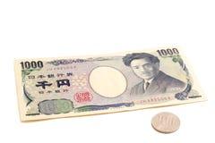 1100 ienes, taxa de imposto de 10% na moeda japonesa Fotos de Stock Royalty Free