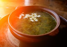 Iet sorrel soup with egg. on a wooden table stock images