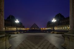 Iew of famous Louvre Museum with Louvre Pyramid at evening Royalty Free Stock Photo