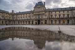 Iew of famous Louvre Museum with Louvre Pyramid at evening Stock Images