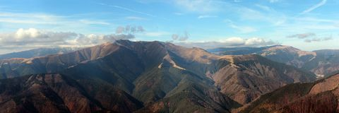 Iezer-Papusa Mountains whit blue sky and clouds. Scenic view panorama with Iezer-Papusa mountains Stock Images