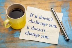 If it does not challenge you ... If it doesn`t challenge you, it doesn`t change you - handwriting on a napkin with a cup of coffee Royalty Free Stock Photo
