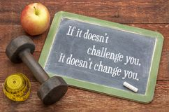 If it does not challenge you ... If it doesn`t challenge you, it doesn`t change you -  slate blackboard sign against weathered red painted barn wood with a Royalty Free Stock Photography