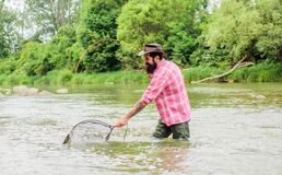 If fish regularly you know how rewarding and soothing fishing is. Fishing hobby. Bearded brutal fisher catching trout
