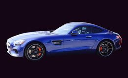 Mercedes AMG GT Blue on Black Background. If the Mercedes-AMG GT is a reinvention of the pure sports car, there`s only one way to make it even purer: Open it up Stock Photos