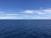 The ocean is blue as well is the sky.