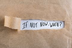 If Not Now When, appearing behind torn brown paper stock photos