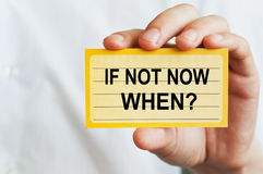 If Not Now, When. Card in male hand stock photography