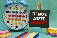 If not now when. ? message written on a small blackboard Royalty Free Stock Photos