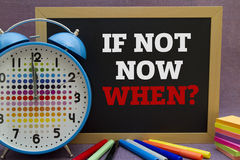 If not now when. ? message written on a small blackboard Royalty Free Stock Photo