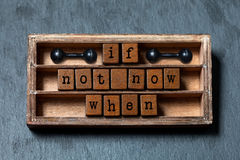 If not now when. Motivation and success future management quote. Vintage box, wooden cubes with old style letters stock images