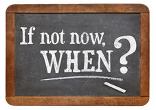 If not now, when question. Call for action or decision - if not now, when question  on  vintage slate blackboard, isolated on white Royalty Free Stock Photo