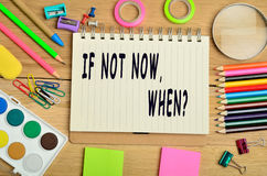 If not now, when?. If not now, when text on notebook Royalty Free Stock Photos