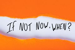 If Not Now When, text in torn orange envelope. Motivating and inspiring question stock image