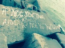 If Not Now Then When?. A picture of graffiti on a rock Royalty Free Stock Image