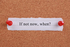 If Not Now When. Typed on a paper note and pinned to a cork notice board Royalty Free Stock Image