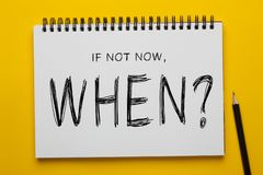 If Not Now, When?. Written on notepad with pencil on yellow background. Motivational concept royalty free stock photos