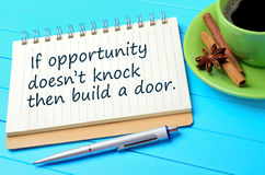 If opportunity doesn`t knock then build a door written on notepad. Closeup royalty free stock image