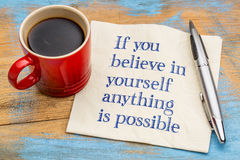 If you believe in yourself  ... If you believe in yourself  anything is possible - handwriting on a napkin with a cup of espresso coffee Royalty Free Stock Photography