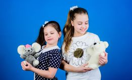 If you carry your childhood you actually never get older. Kids cute girls play with soft toys. Happy childhood. Child stock photos