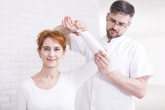 If you have arm problem go to physiotherapist Stock Photo