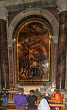 People pray inside Vatican Basilic. If you are interested by tremendous architecture, rich work on paintings and cult objects or just to pray a moment, Vatican Royalty Free Stock Images