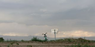 Bicycle next to the road with mountains in the distance royalty free stock images