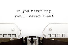 If you never try you will never know. If you never try you'll never know! printed on an old typewriter stock images
