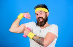 If you want to be strong. Motivated athlete guy. Sportsman retro outfit training blue background. Join my sport class. Athlete training with cute dumbbell. Man royalty free stock photography
