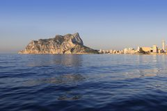 Ifach Penon mountain in Calpe from blue sea Stock Photos