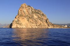 Ifach Penon mountain in Calpe from blue sea. In Alicante province Spain Royalty Free Stock Photography