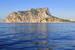Ifach Penon mountain in Calpe from blue sea. In Alicante province Spain Royalty Free Stock Photo
