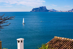 Ifach Penon view of calpe  in Alicante. Ifach Penon view of calpe and Sailboat from Moraira in Mediterranean Alicante at Spain Stock Images