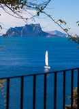 Ifach Penon view of calpe  in Alicante. Ifach Penon view of calpe and Sailboat from Moraira in Mediterranean Alicante at Spain Stock Image